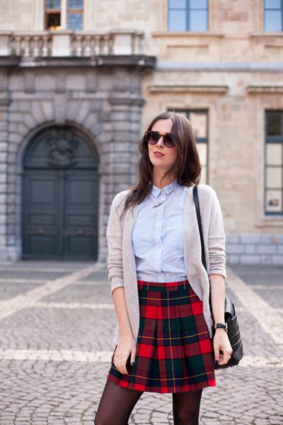 light blue button up shirt with grey cardigan and read and black plaid mini skirt