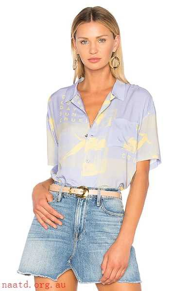 light blue printed tucked shirt with blue mini skater denim skirt