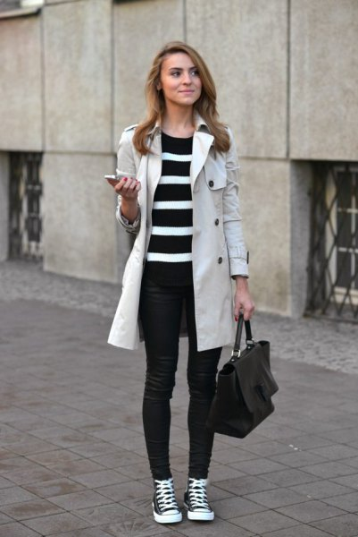 light grey longline coat with black and white striped tunic sweater and jeans