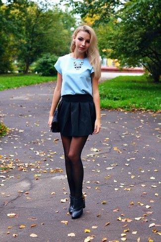 light sky blue blouse with black mini skater skirt