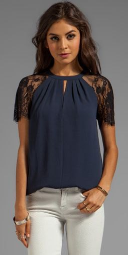 navy blue lace short sleeve blouse with white skinny jeans