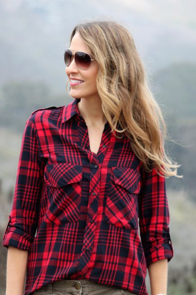 red and black plaid hiking shirt with grey jeans