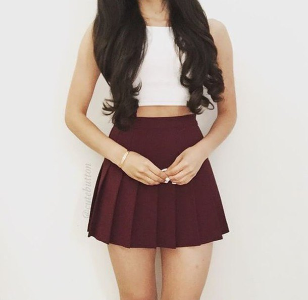 white crop top with pleated mini maroon skirt