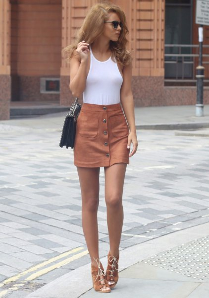 white form fitting tank top with camel button front high rise skirt