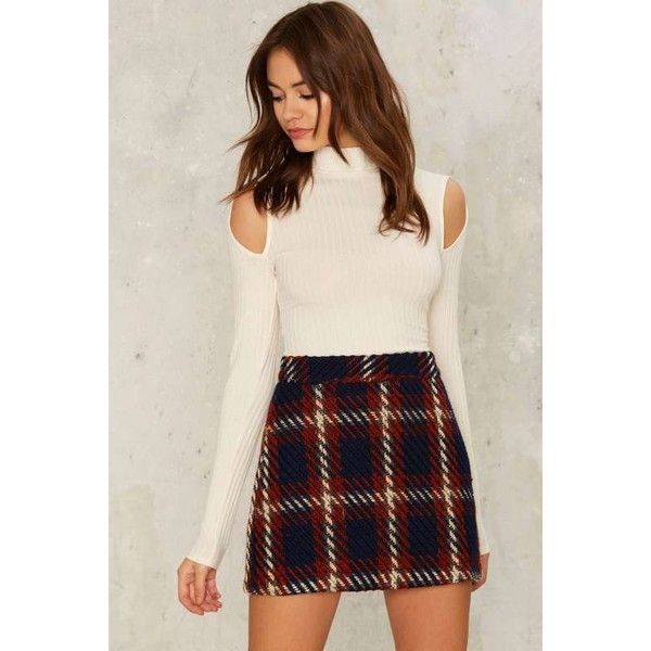 white mock neck cold shoulder ribbed sweater with black plaid wool mini skirt
