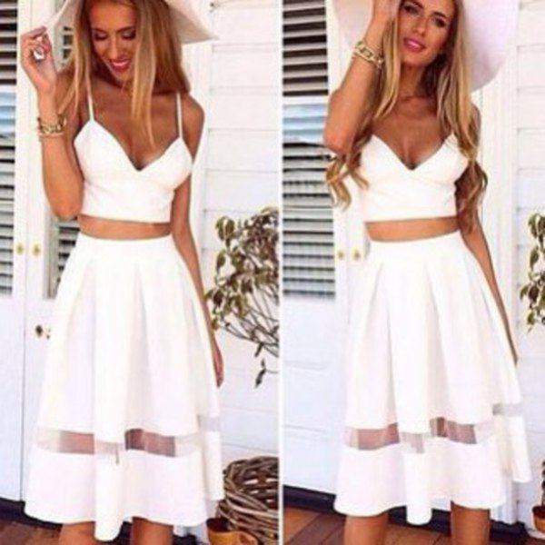 white sweetheart form fitting crop top with high rise flared midi skirt