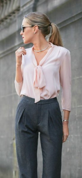 white tie neck silk blouse with grey high waisted chinos