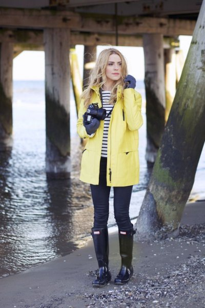 yellow rain jacket with black and white striped tee and boots