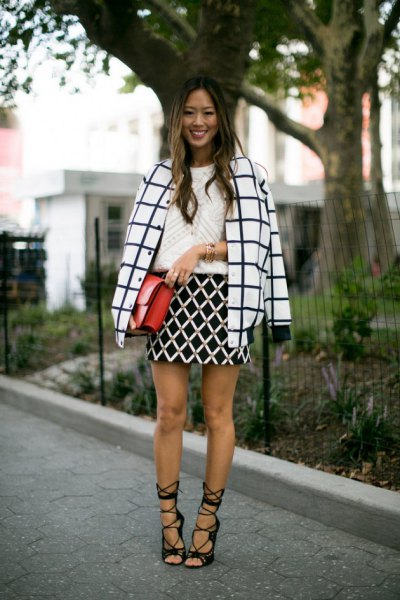 black and white plaid wool coat with heeled black lace up sandals