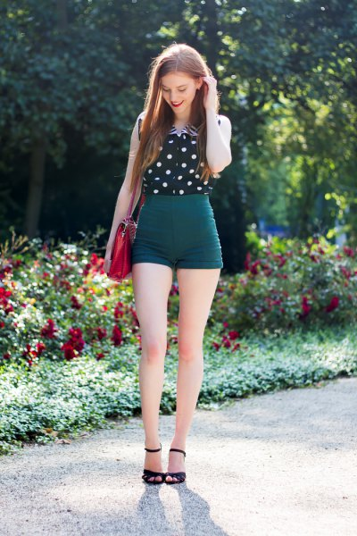 black and white polka dot sleeveless shirt with high waisted vintage shorts