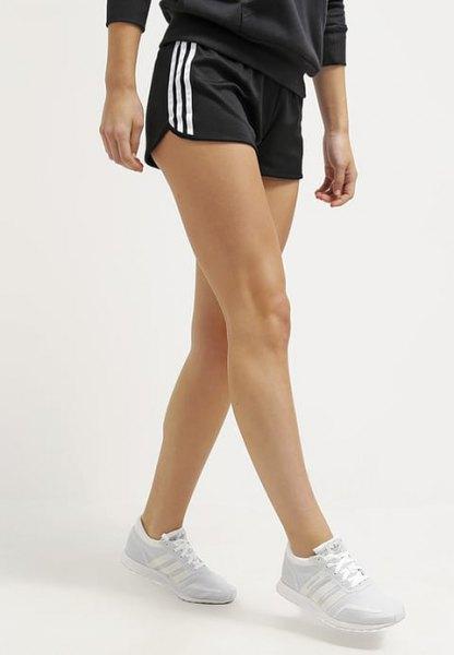 black and white striped mini running shorts with grey sweatshirt