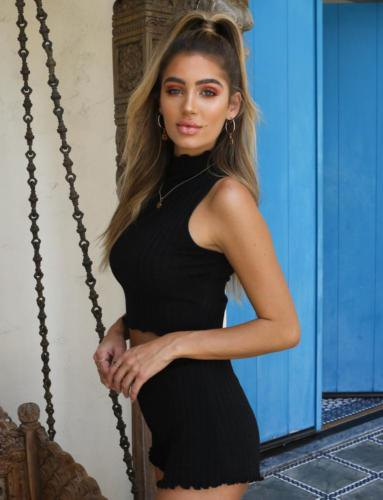 black halter neck crop top with scalloped hem high waisted knit shorts