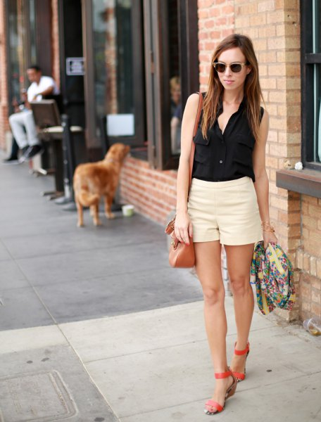 black sleeveless button up shirt with pale yellow mini summer shorts