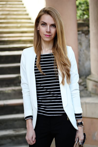 black striped long sleeve top with white bomber jacket
