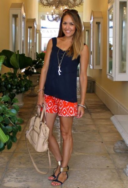 black sweetheart neckline relaxed fit tank top with orange tribal printed shorts