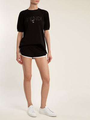 black t shirt with matching mini running shorts