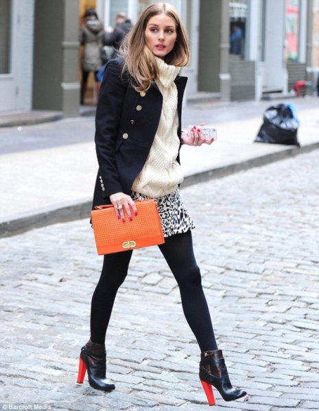 black wool coat with leopard print mini skirt and brown leather clutch handbag