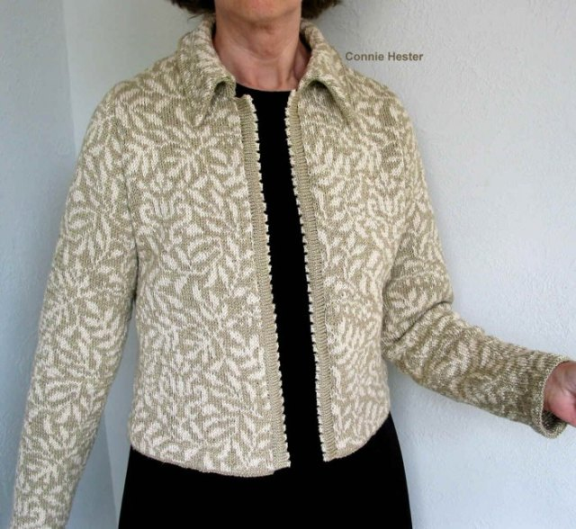 grey and white knit fitted jacket with black shift dress