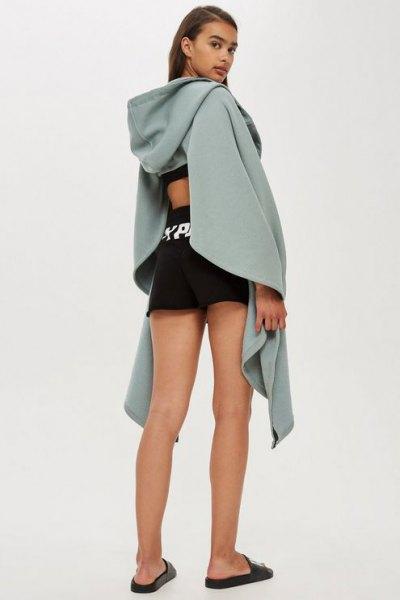 grey draped cutout back hoodie with black mini running shorts
