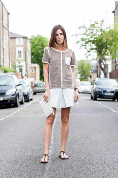 grey top with white mini skater skirt and black flip flops