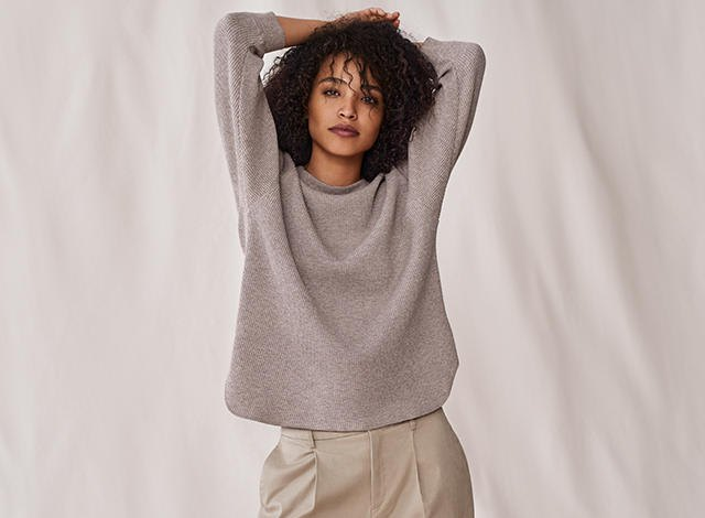 heather grey sweater with pink mini sweatpant shorts