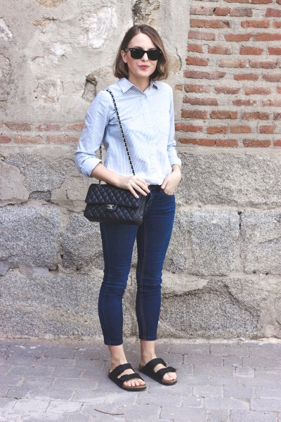 light blue button up slim fit shirt with dark skinny jeans and navy sandals