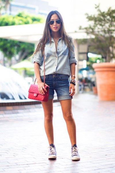 light blue chambray shirt with cuffed denim summer shorts