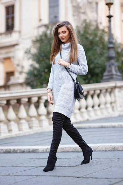 light grey knee length knit dress with black suede thigh high heeled boots