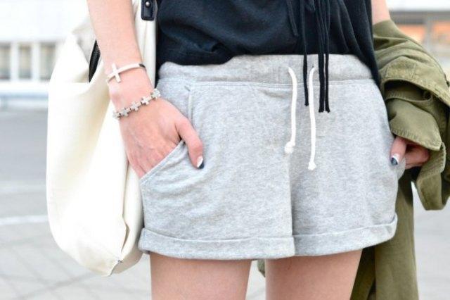 light grey running mini shorts with black tank top