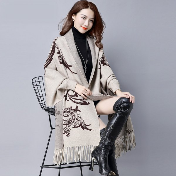 light grey tribal printed long fringe shawl with black thigh high leather boots