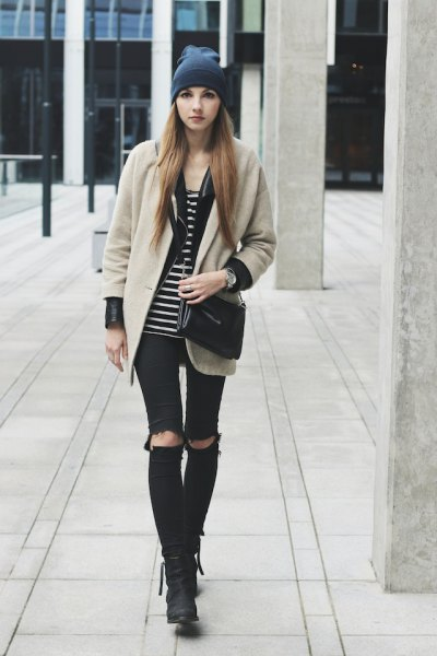 pale pink wool coat with black and white striped tank top