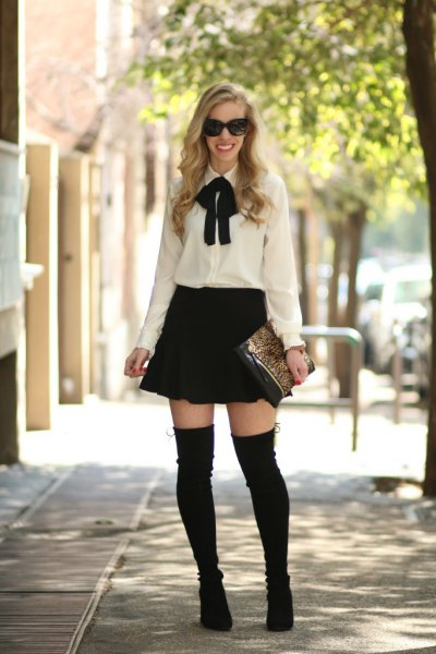 white and black bow tie blouse with skater skirt and thigh high boots
