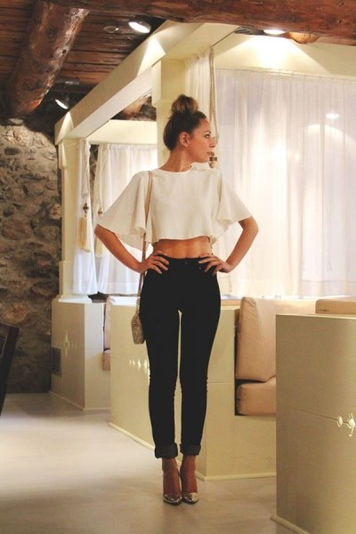 white batwing cropped going out top with black cuffed slim fit jeans