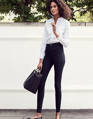 white button up formal shirt with high rise black skinny ankle jeans