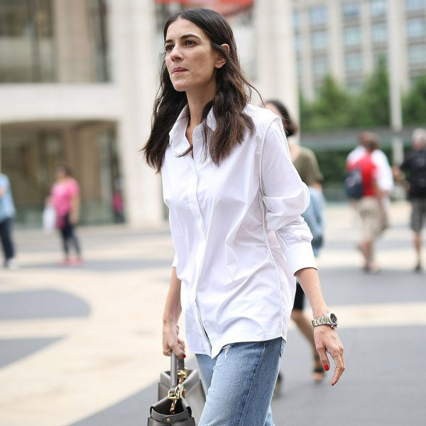 white button up oversized formal shirt with blue straight leg jeans