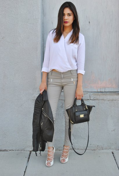 white buttonless shirt with grey skinny jeans and heeled sandals
