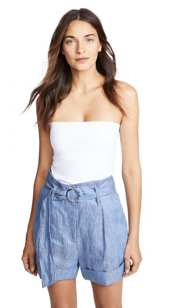 white form fitting tube top with blue striped mini shorts