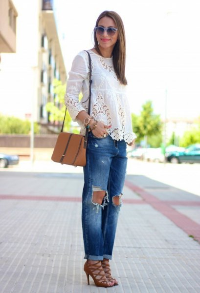 white long sleeve blouse with ripped jeans and red strappy lace up heels