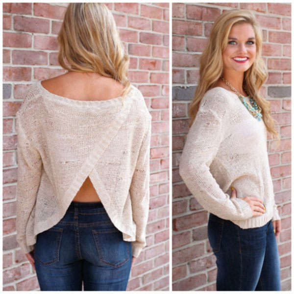 white semi sheer subtly open back sweater with blue skinny jeans