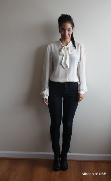 white shirt with matching bow tie and skinny black jeans