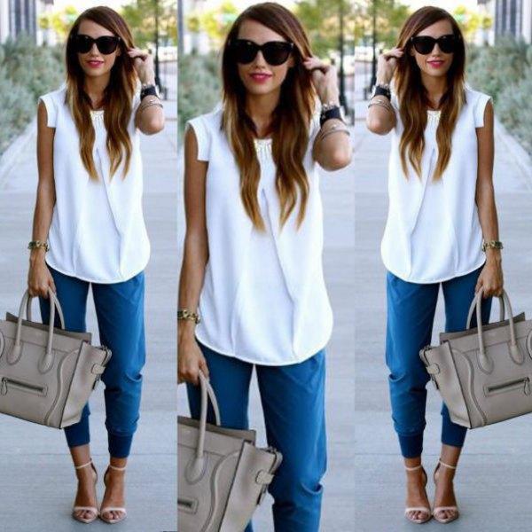 white sleeveless chiffon blouse with blue tapered leg pants