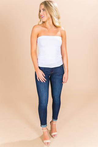 white tube top with dark blue cuffed skinny jeans