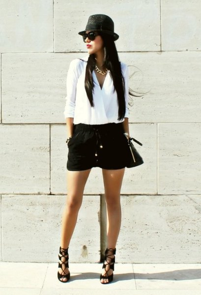 white wrap blouse with black mini short and flat hat