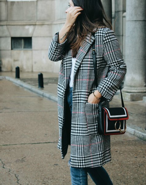 black and white plaid coat with white top and blue jeans