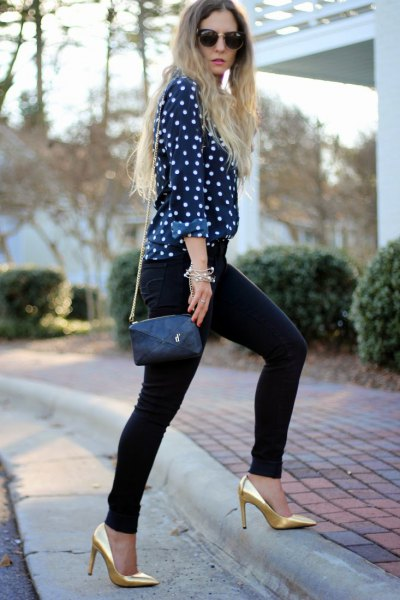 black and white polka dot blouse with gold heels