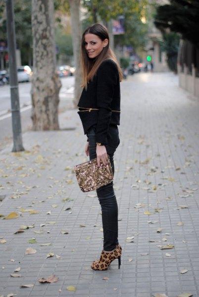 black blazer with dark blue skinny jeans and animal print heels