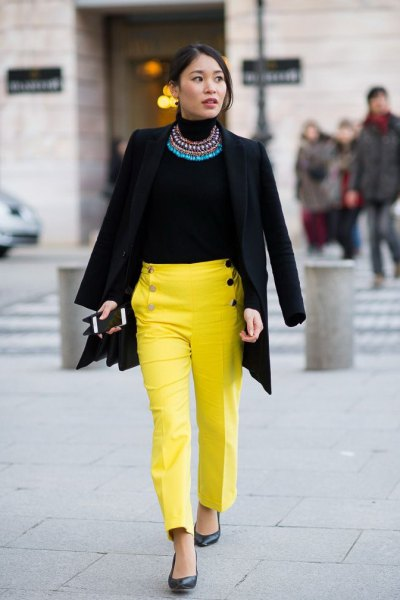 black blazer with statement necklace and yellow straight leg chinos