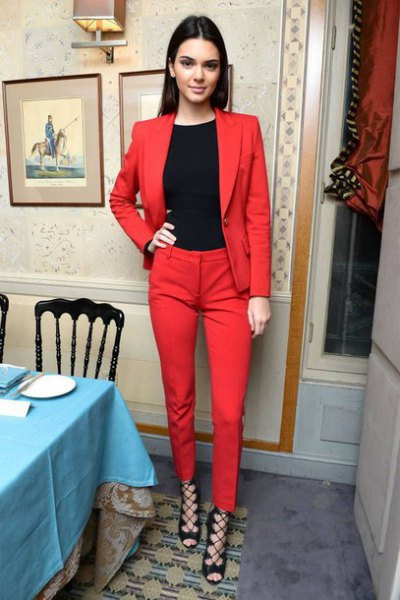 black crew neck tee with red suit and open toe strappy heels