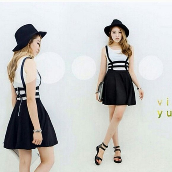 black felt hat with strappy suspender mini skirt and slide sandals