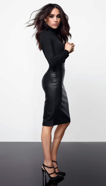 black form fitting sweater with knee length leather skirt